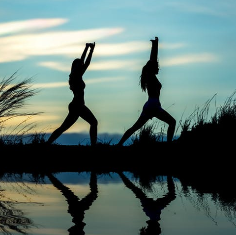 Two Women Doing Yoga